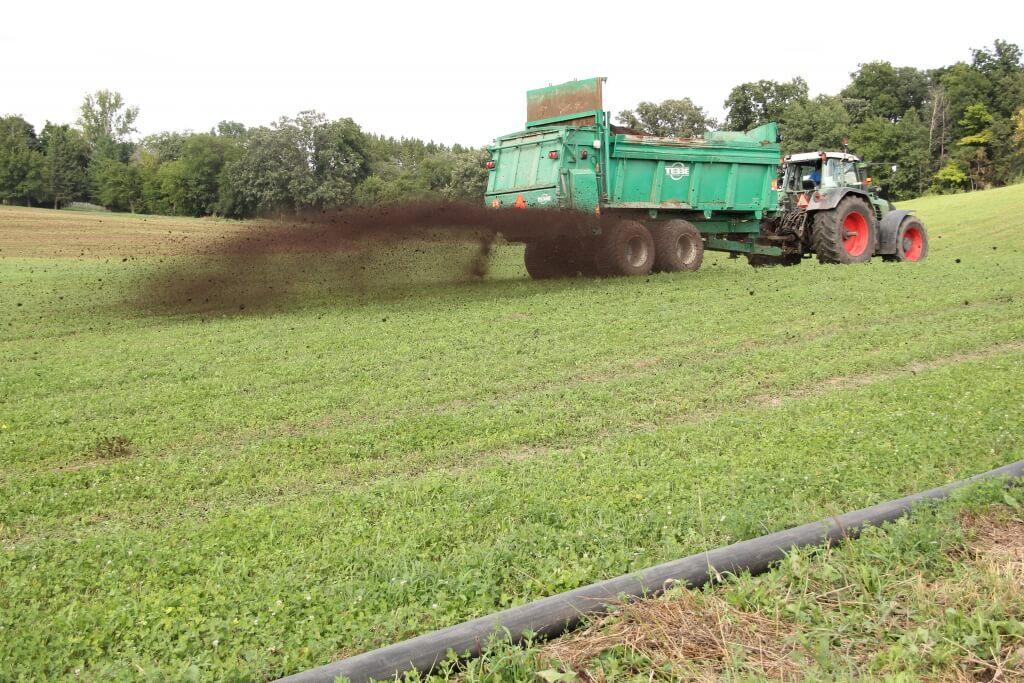 Composted manure spreader