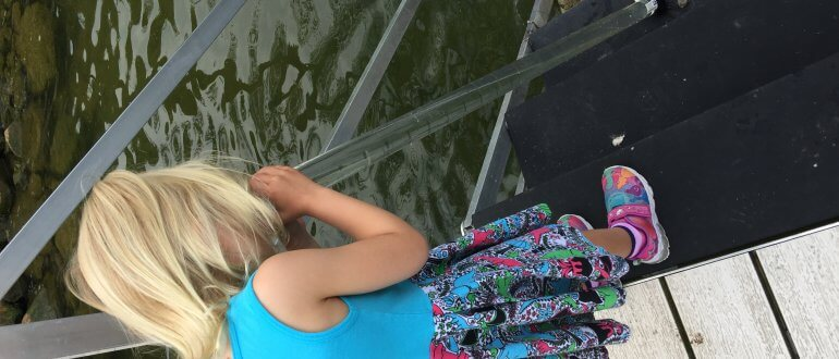 Water quality monitoring - child looks in turbidity tube