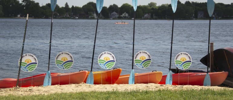 Kayaks and paddles at Brittingham Boats in front of Lake Monona