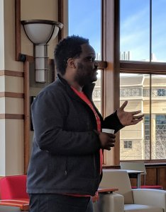 Reuben Sanon of Badger Volunteers speaks to the April 2019 Yahara Watershed Academy