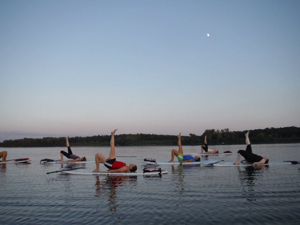 SUP Yoga (Courtesy Wingra Boats) - why not add a big exhale to your summer bucket list?