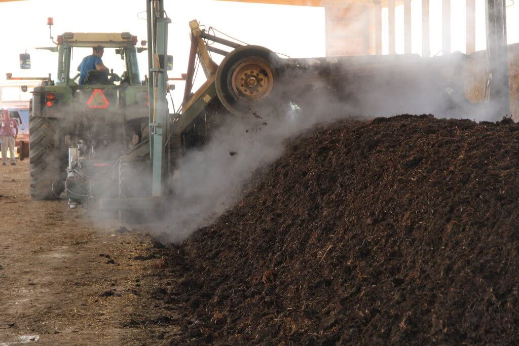 The rows of composted manure undergoes a process which helps speed up the drying time of the organic material