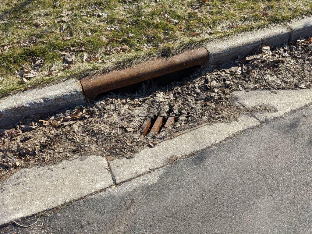Storm drain and debris - springtime